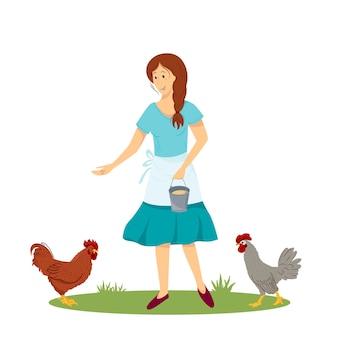 Junge frau oder bäuerin füttert die hähne mit geflügelkorn das mädchen kümmert sich um hühner