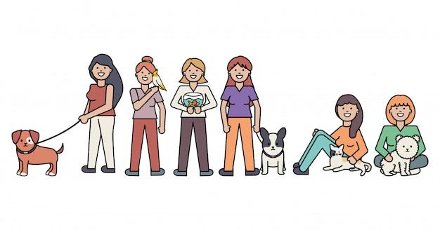 Junge frauen mit niedlichen katzen- und hundemaskottchen