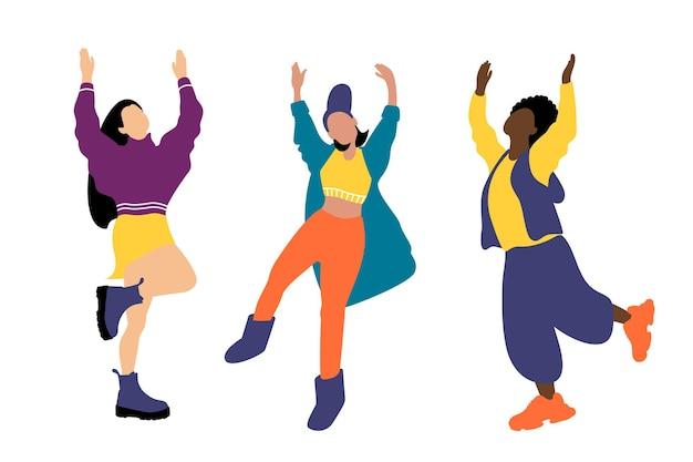 Junge frauen verschiedener nationalitäten tanzen. mädchen in modischer kleidung haben spaß auf einer party. flache vektorillustration der karikatur. internationaler frauentag
