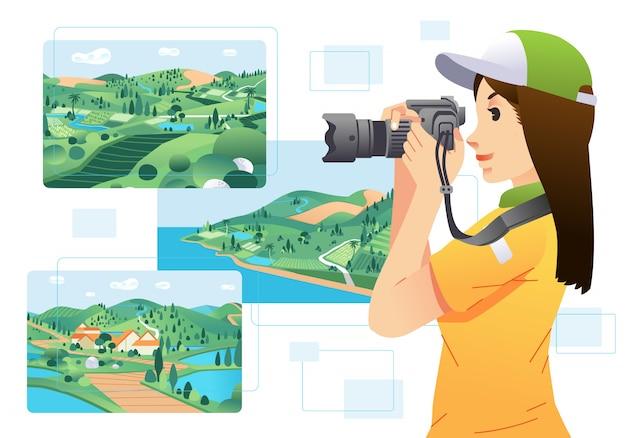 Junge frauenfotografin, die eine kamera hält und bilder der landschaft macht