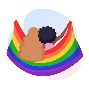 Junge frauenpaare umarmen sich und halten eine regenbogen-lgbt-stolzflagge.