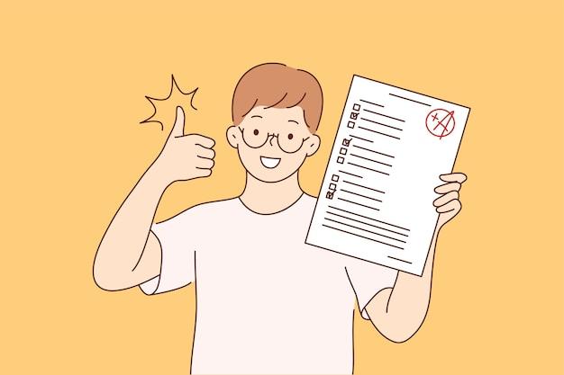 Junge glückliche fröhliche lächelnde junge schülerfigur, die mit testprüfungsergebnissen steht, die daumen hoch zeigen