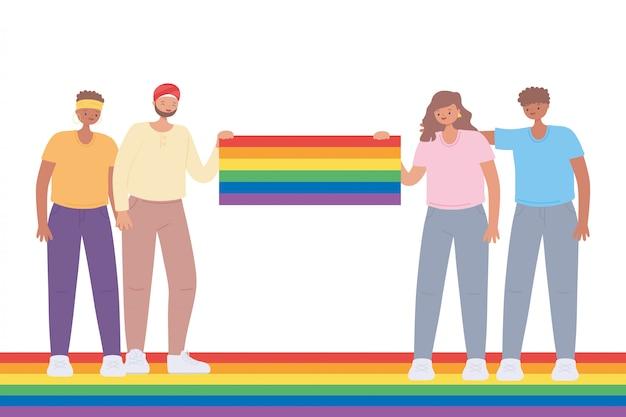 Junge gruppe von leuten mit großer regenbogenfahne