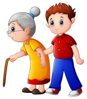 Junge hilft alter dame und hilft ihr, mit ihrem stock zu gehen