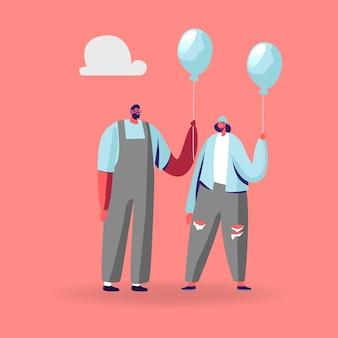 Junge identische männliche und weibliche charaktere in moderner modischer kleidung, die blaue luftballons hält.