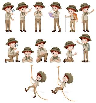 Junge im safari-outfit, der verschiedene posen macht