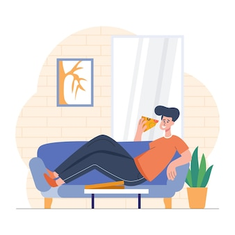 Junge isst pizza auf dem sofa