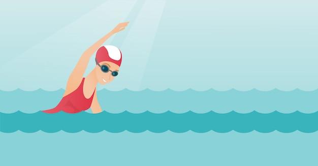 Junge kaukasische sportlerinschwimmen