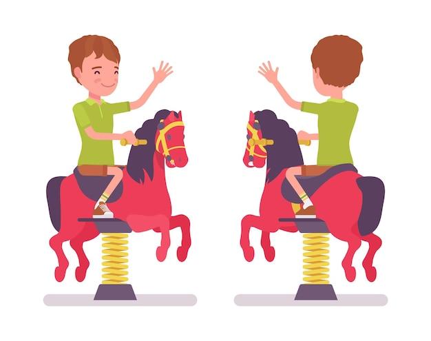 Junge kind 7-9 jahre schulpflichtiges kind bei horse spring rider