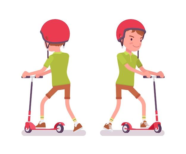 Junge kind 7 bis 9 jahre alt, kind im schulpflichtigen alter, das einen tretroller fährt