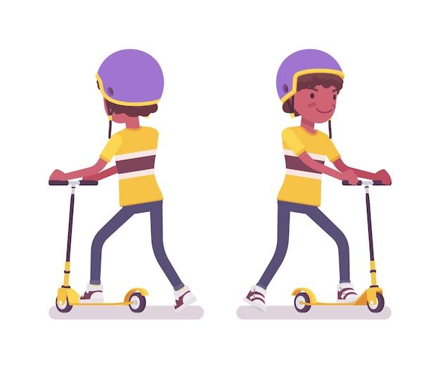 Junge kind 7 bis 9 jahre alt, schwarzes kind im schulalter, das einen tretroller fährt