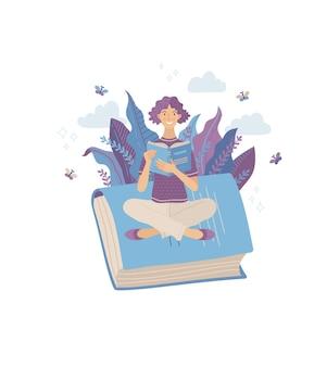 Junge lächelnde frau, die buch liest, während sie auf riesenbuch sitzt