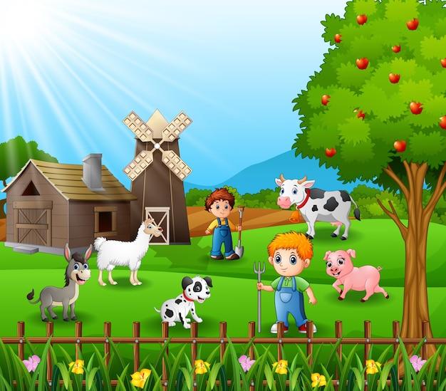 Junge landwirte, die tiere am bauernhof halten