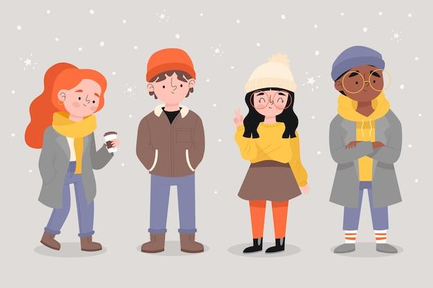 Junge leute, die winterkleidung an einem schneebedeckten tag tragen