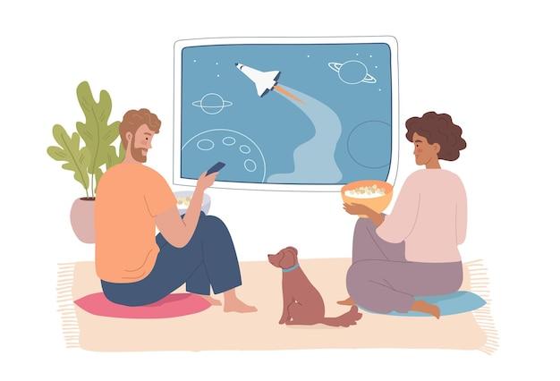 Junge leute, mann und frau, die fernsehsendungen über den weltraum ansehen