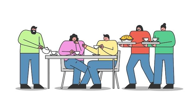Junge leute versammeln sich auf der teeparty. gruppe von freunden, die sich beim tee treffen, am tisch sitzen, trinken und reden