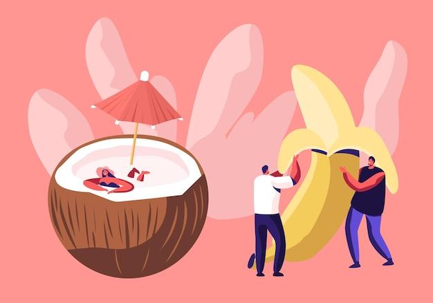 Junge männer, die riesige geschälte banane und frau im badeanzug halten entspannen in kokosnuss mit regenschirm