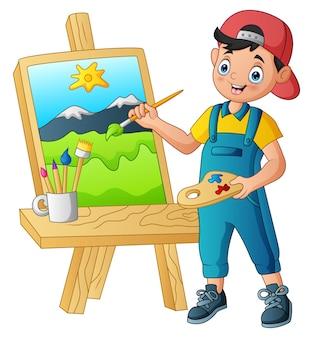 Junge malt eine landschaft auf der leinwand