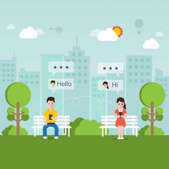 Junge menschen am telefon in einem park im gespräch
