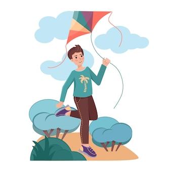 Junge mit fliegendem drachen in den händen