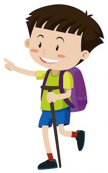 Junge mit rucksack und spazierstock