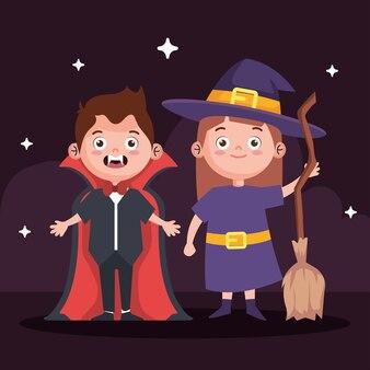 Junge mit vampir und mädchen mit hexenkostüm