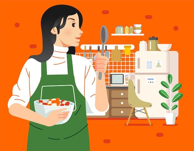 Junge mutter, die in der küche kocht, sie hält schüssel und löffel mit kücheninnenraum als hintergrundillustration. wird für poster, webbilder und andere verwendet