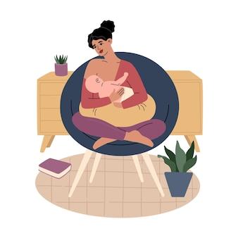 Junge mutter hält neugeborenes kind. lächelnde frau, die auf einem stuhl sitzt und ihr baby stillt.