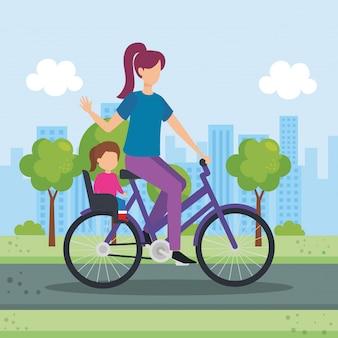 Junge mutter im fahrrad mit tochter im park