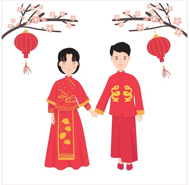 Junge paare tragen traditionelles chinesisches kleid mit laterne, pflaumenblüte