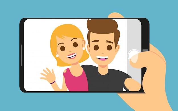Junge paarfrau, mann, der selfie foto auf smartphone macht