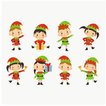 Junge reizende nette kinder der sammlung im weihnachtselfenkostüm