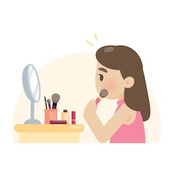 Junge schöne frau, die make-up unter verwendung einer bürste auf gesicht macht