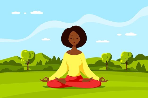 Junge schwarze frau, die im lotussitz mit schöner landschaft sitzt. praxis von yoga und meditation, erholung, gesunder lebensstil.