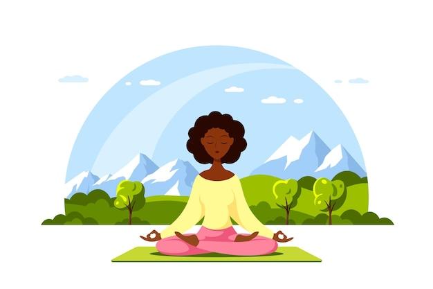 Junge schwarze frau sitzt im lotussitz mit schöner berglandschaft. praxis von yoga und meditation. flache illustration isoliert