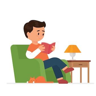 Junge sitzt und liest ein buch