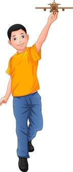Junge spielt mit holzflugzeug