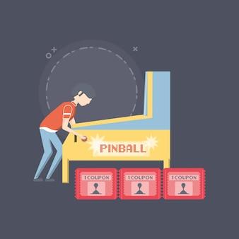Junge spielt pinball arcade-maschine und gutscheine