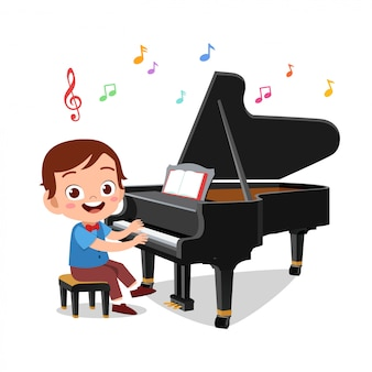 Junge und ein mädchen, die klavier spielen