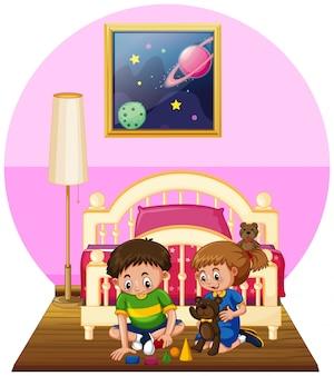 Junge und mädchen, die spielwaren im schlafzimmer spielen