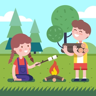 Junge und mädchen in der nähe des lagerfeuers