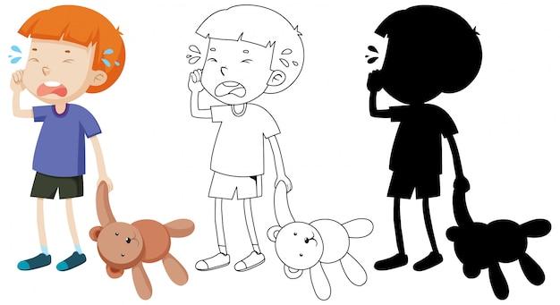 Junge weint und hält teddybär mit seinem umriss und der silhouette