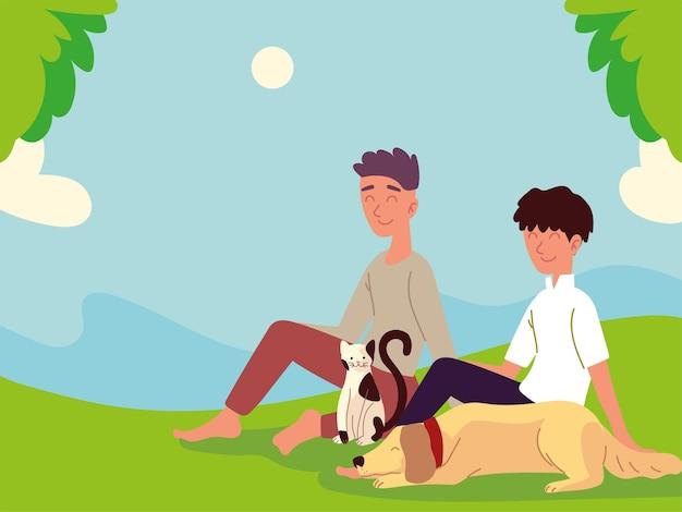 Jungen mit haustieren im gras