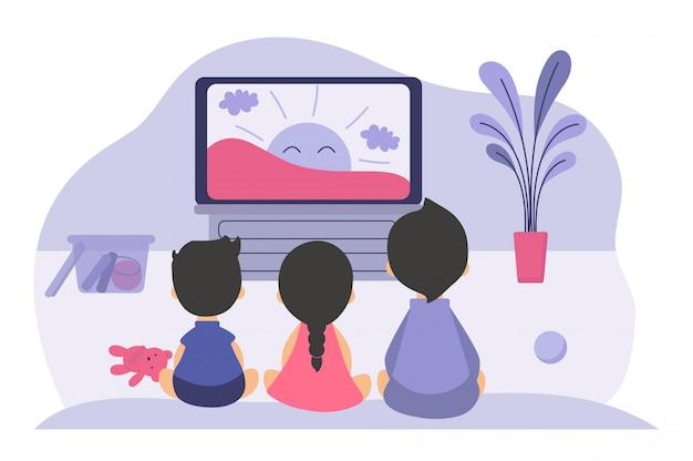 Jungen und mädchen sitzen am fernsehbildschirm