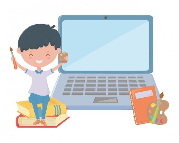 Jungenkind der schule und des laptops