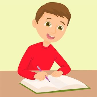 Jungenschreiben an seinem schreibtisch
