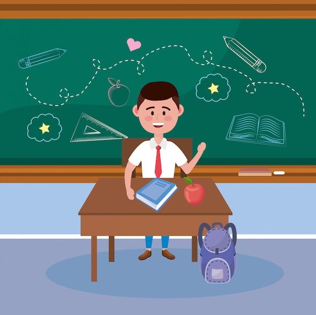 Jungenstudent mit buch- und apfelfrucht im schreibtisch
