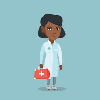 Junger afrikanischer doktor, der einen kasten der ersten hilfe anhält.