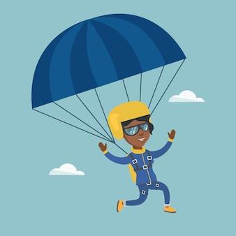 Junger afrikanischer skydiver, der mit einem fallschirm fliegt.