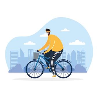 Junger afro-mann, der fahrrad trägt, das medizinische maske trägt